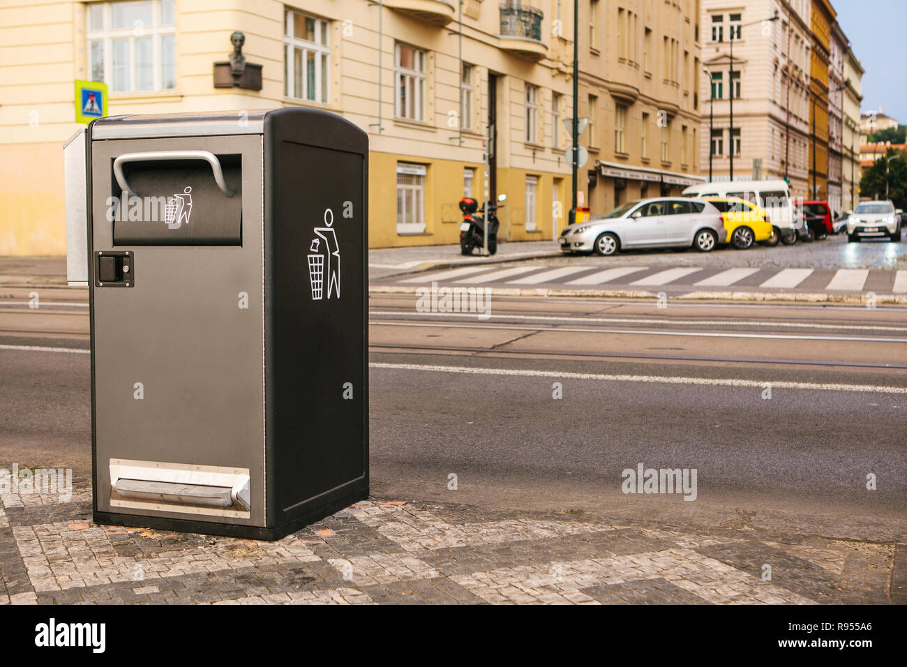 A modern clever trash can on the street in Prague in the Czech Republic. Collection of waste in Europe for subsequent disposal. Eco-friendly waste collection - Stock Image