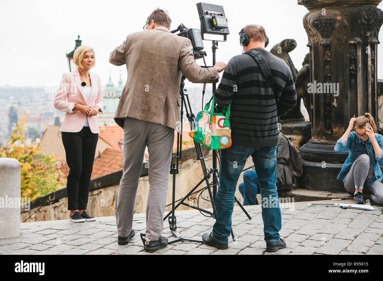 Prague, October 28, 2017: Team of operators and journalists shoot report next to the Prague Castle. - Stock Image