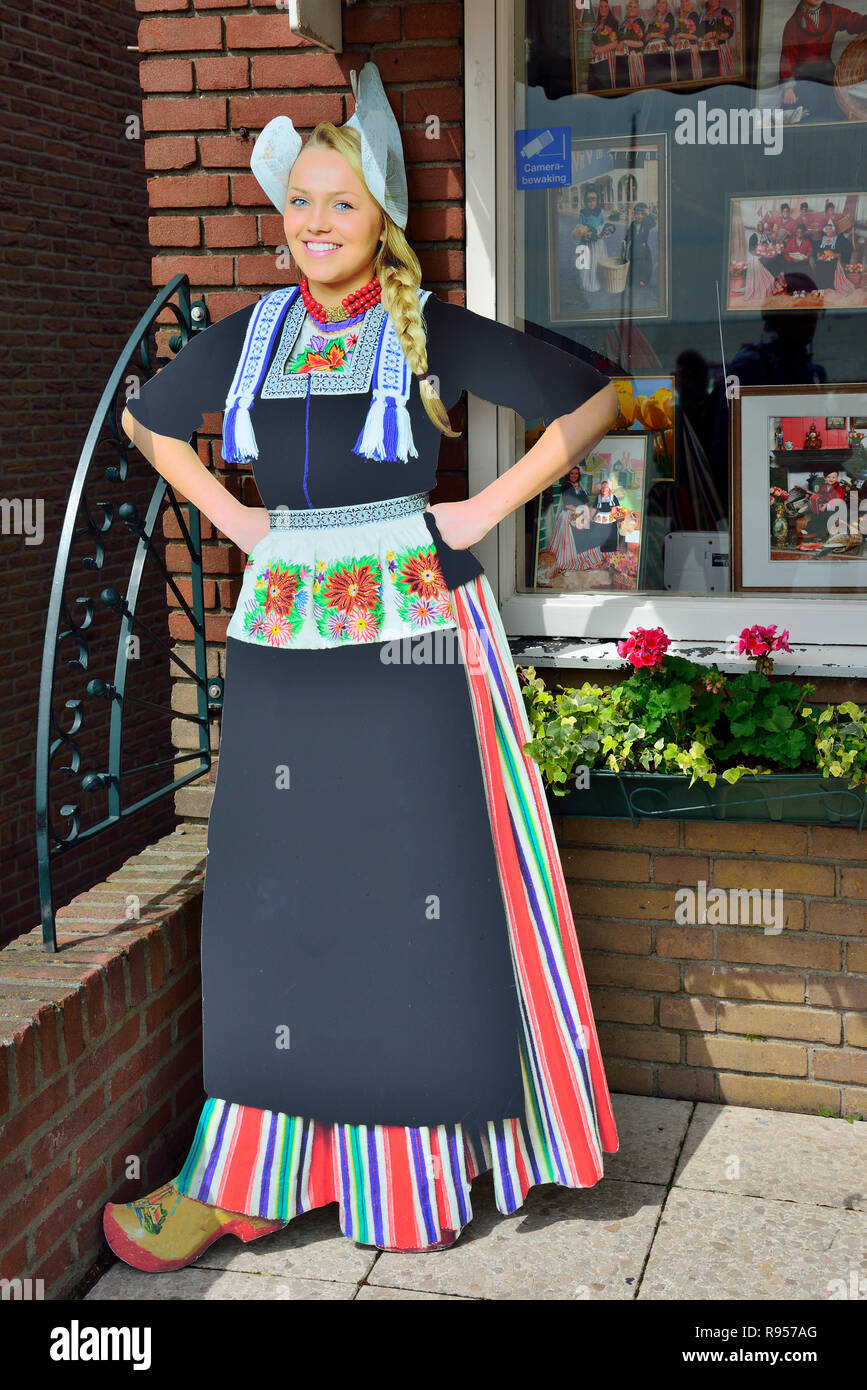 Cardboard cut out of Dutch girl in traditional costume in the tourist town of Volendam, North Holland, The Netherlands - Stock Image