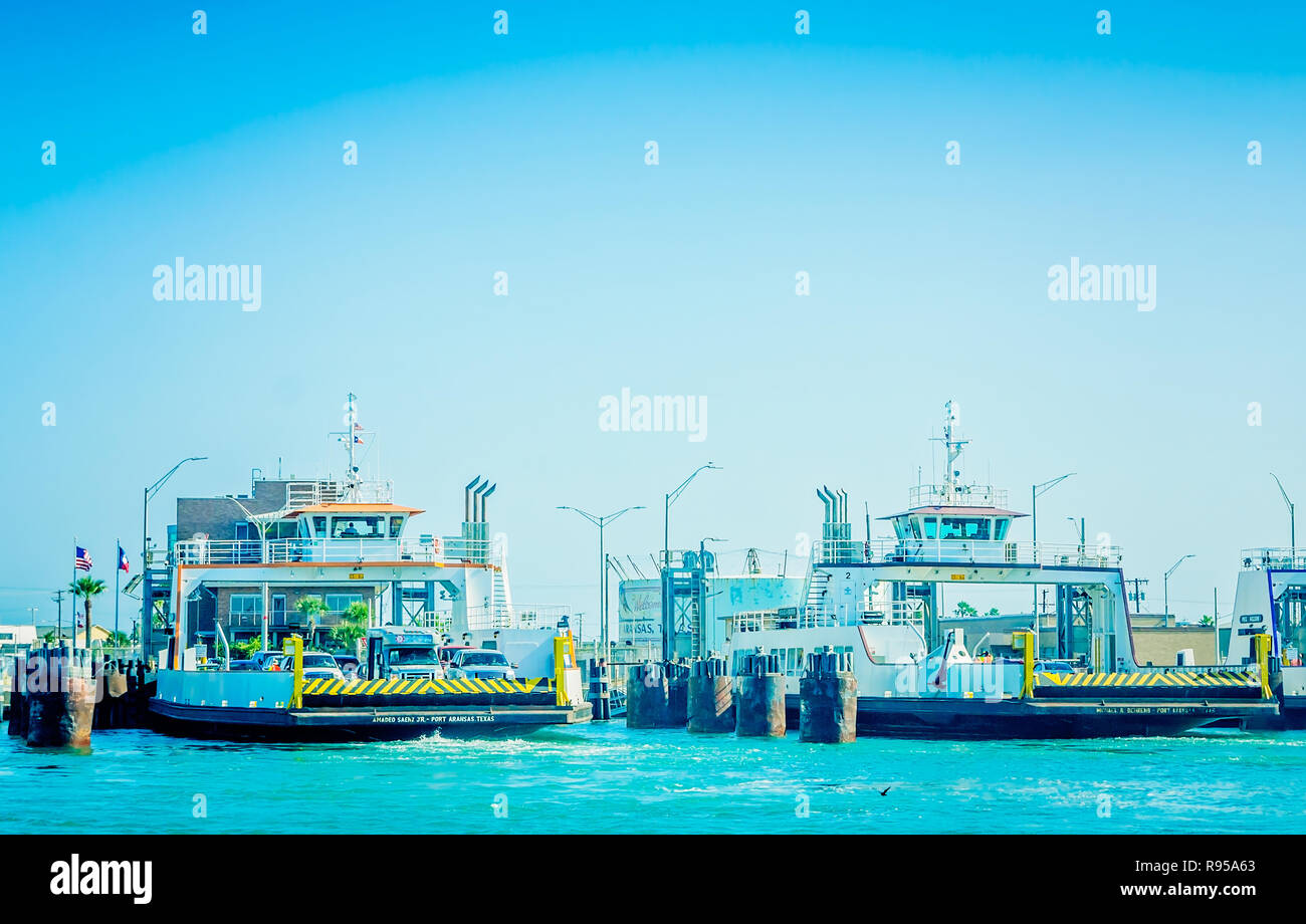 Ferries wait to carry passengers from Port Aransas to the Aransas Pass Ferry Landing, Aug. 25, 2018, in Port Aransas, Texas. - Stock Image