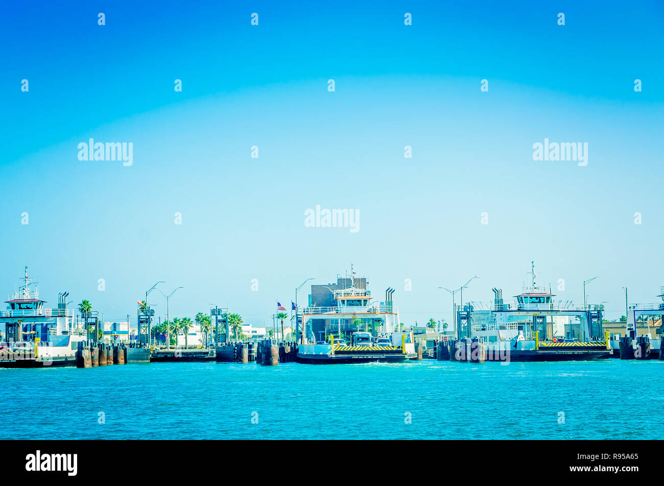 Ferries wait to take passengers from Port Aransas to Aransas Pass, Aug. 25, 2018, in Port Aransas, Texas. - Stock Image