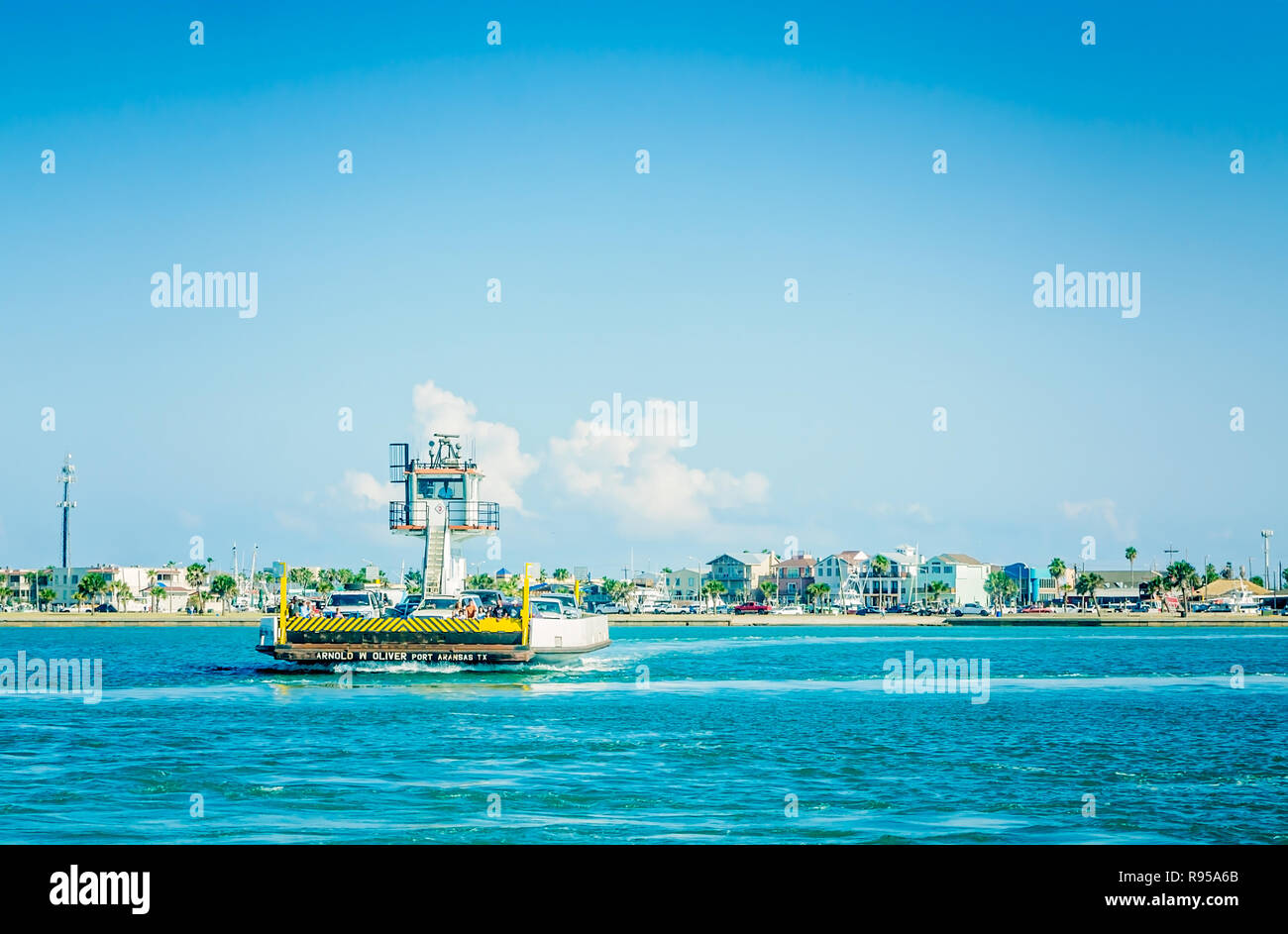 The Arnold W. Oliver ferry shuttles passengers from the Aransas Pass ferry terminal to the Port Aransas ferry landing, in Port Aransas, Texas. - Stock Image