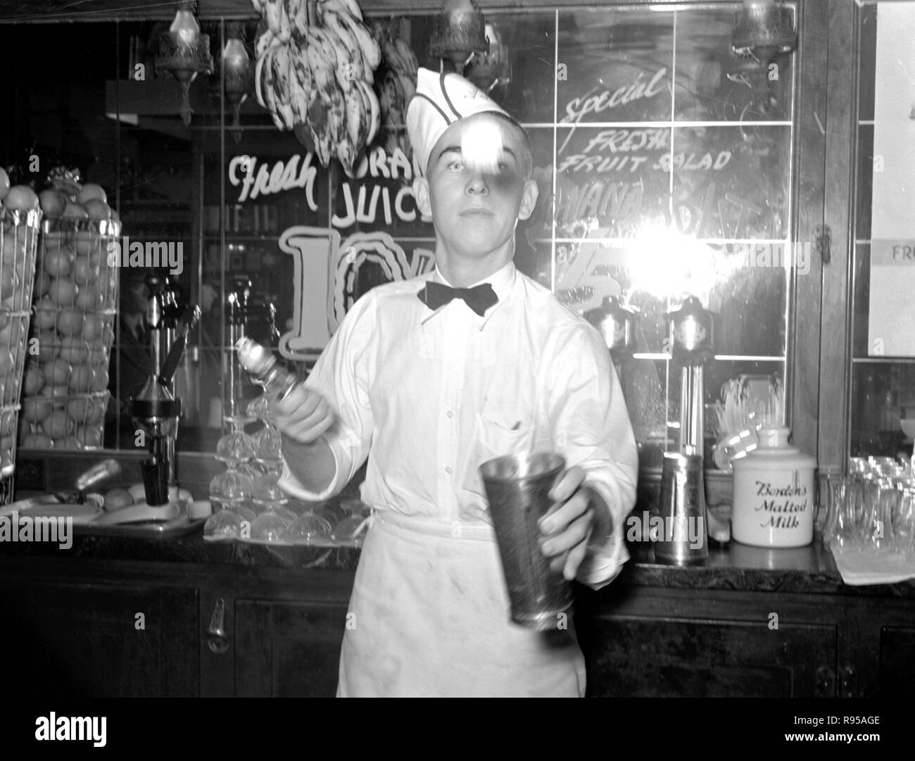 Soda jerker flipping ice cream into malted milk shakes. Corpus Christi, Texas. Circa  February 1939.  Photograph by Russell Lee/FSA (1903-1986) - Stock Image