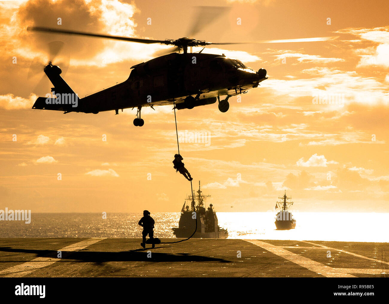 Detachment 9 fast ropes from an SH-60 Seahawk helicopter