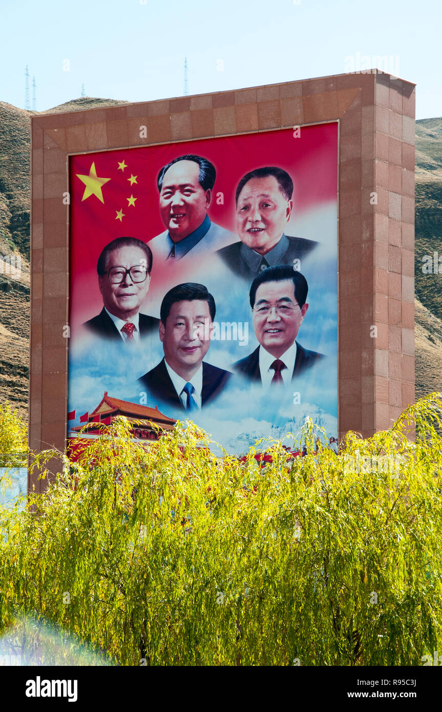Past and present Chinese leaders celebrated on a billboard near the international airport terminal at Lhasa, Tibet, China - Stock Image