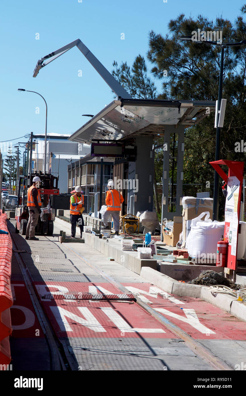 Concrete workers pouring concrete in Scott Street to build the Newcastle Light Rail (Tram) service for the city. Stock Photo