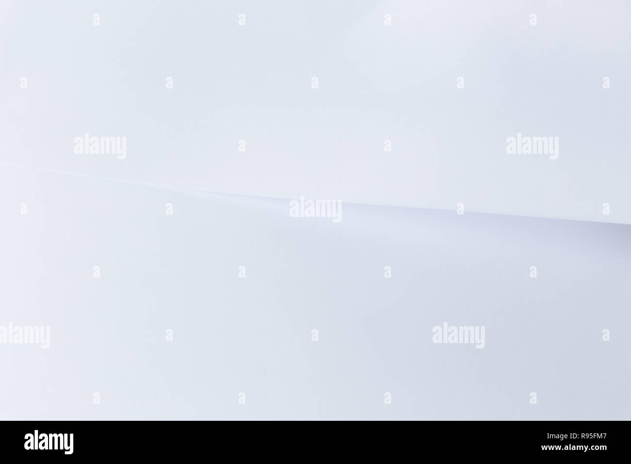 Clean white sheet of paper overlayed with another white paper. Very simple and minimal abstract background. - Stock Image