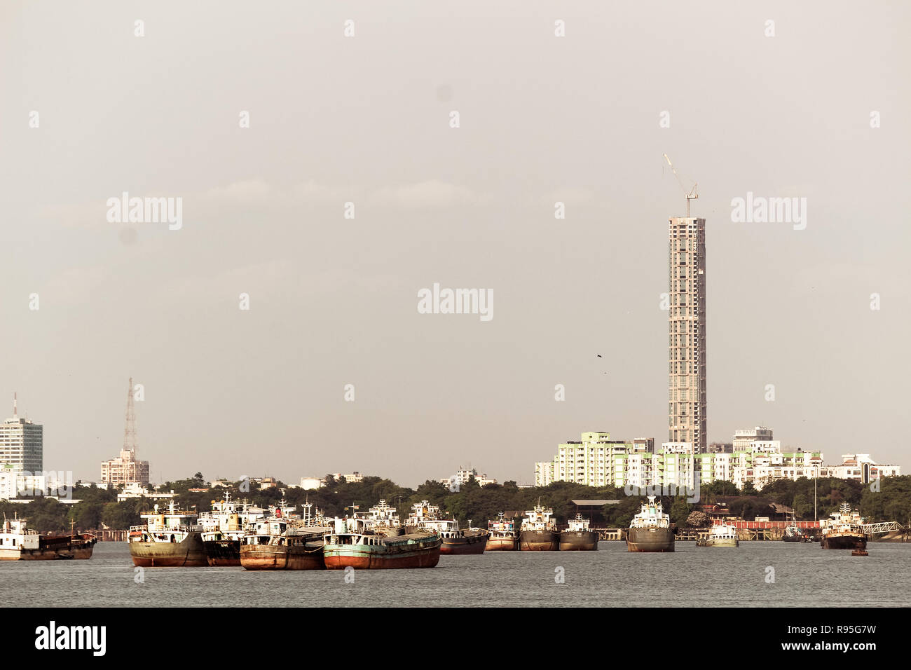 Kolkata, India - May 13, 2018: Beautiful panorama of Kolkata city on the river Hooghly in a sunny day. Fishing trallers are floating on the river. - Stock Image