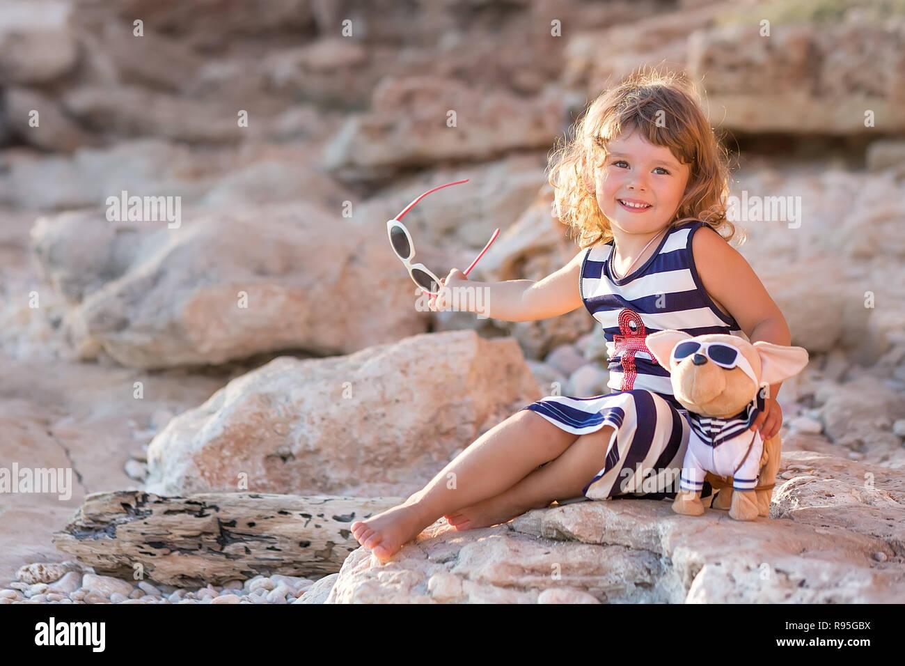 Beach Cute Girl Posing On A Rocky Beach Barefooted With Curly Hair