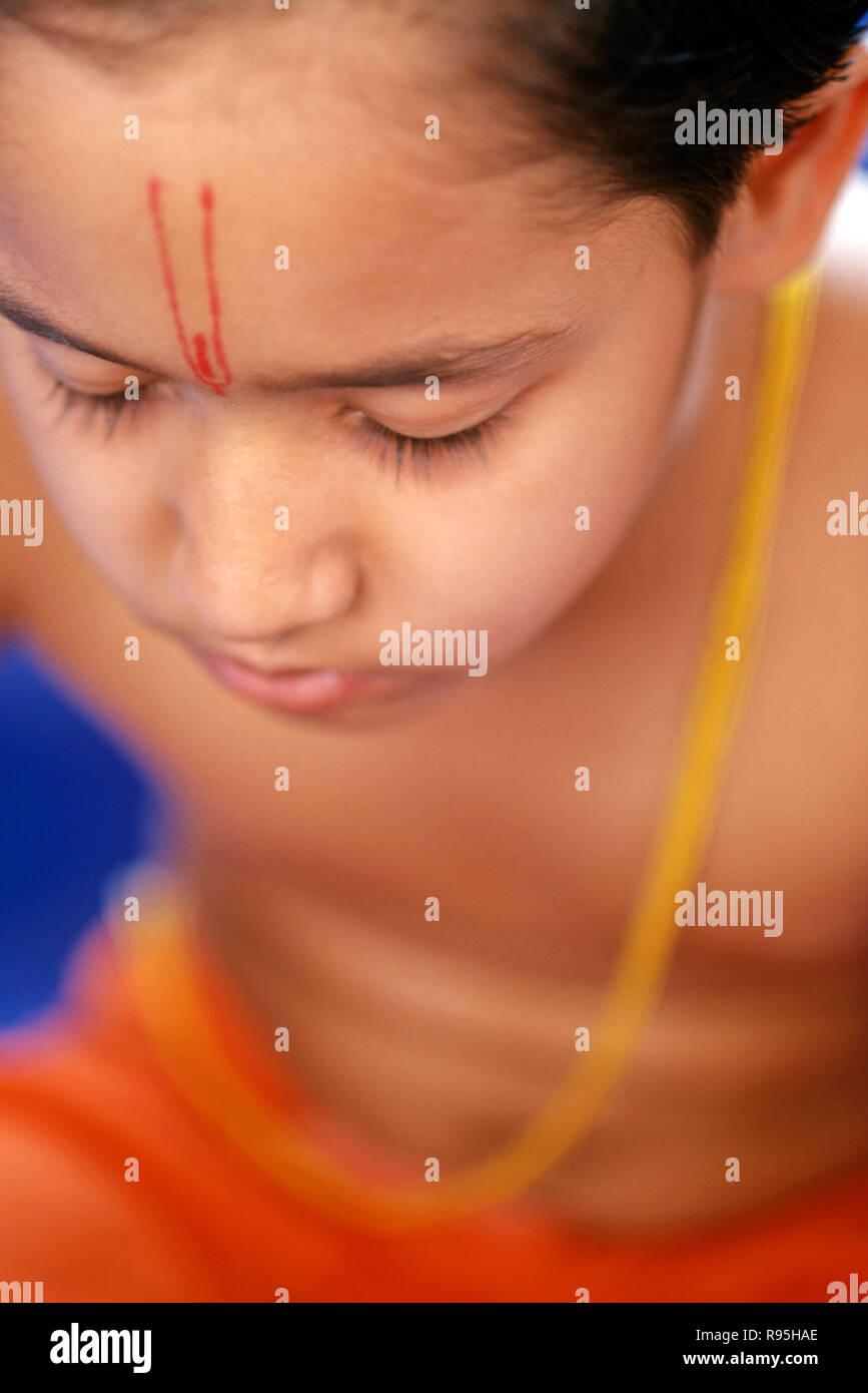 Boy doing Prayers - Stock Image