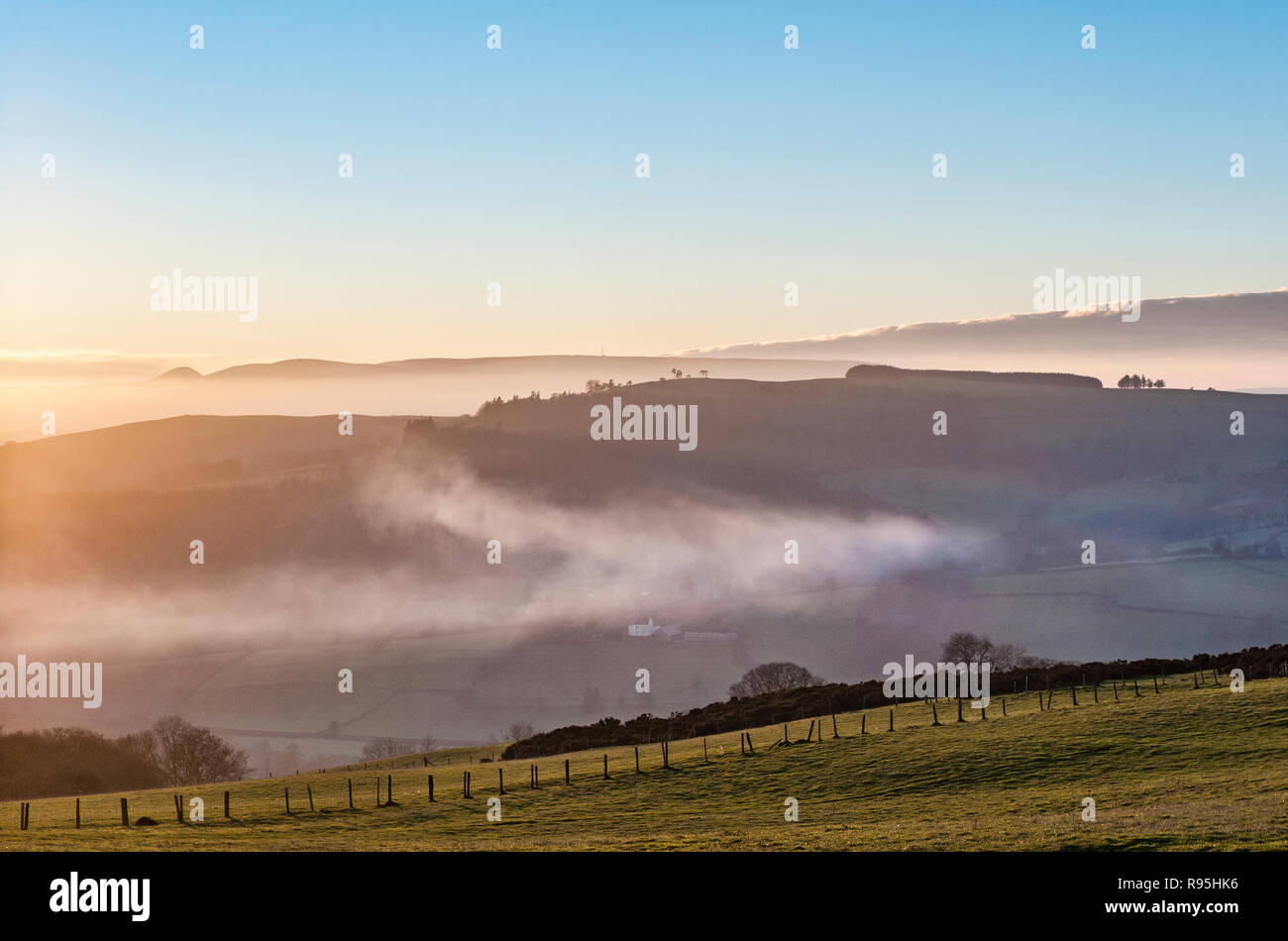 Powys, UK, winter. Evening on Stonewall Hill in the border country between England and Wales. - Stock Image