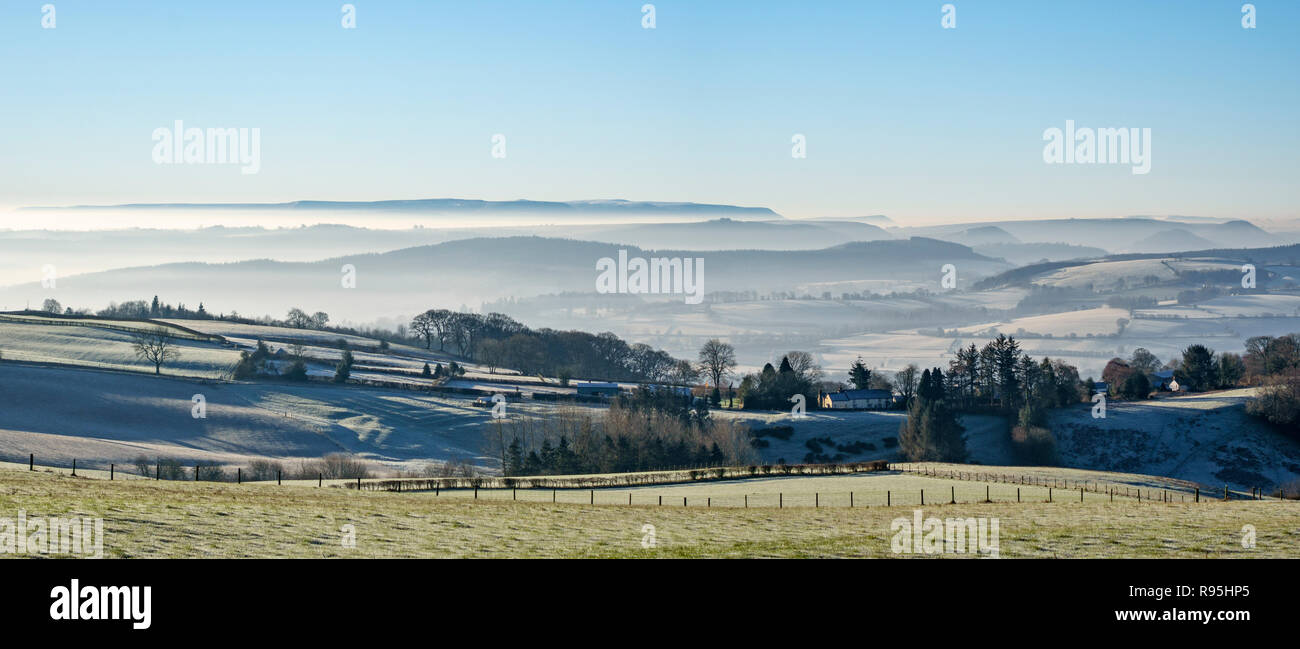 Powys, UK, winter. On Stonewall Hill in the border country between England and Wales. View to distant Hay Bluff and the Black Mountains - Stock Image