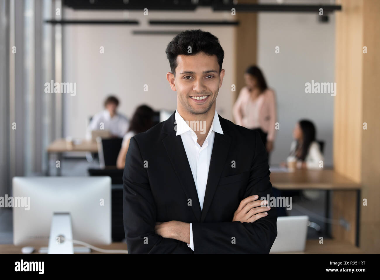 Middle eastern ethnicity businessman in suit posing in coworking - Stock Image