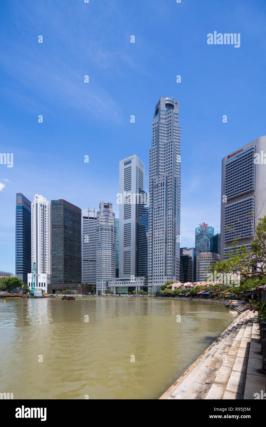 View of One Raffles Place and Singapore when walking along Boat Quay, Singapore. - Stock Image