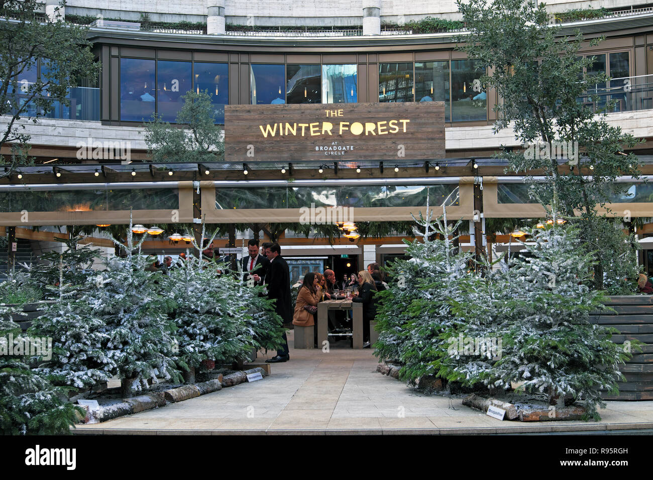 The Winter Forest bar and grill with Christmas trees at Broadgate Circle in The City of London England UK  KATHY DEWITT Stock Photo