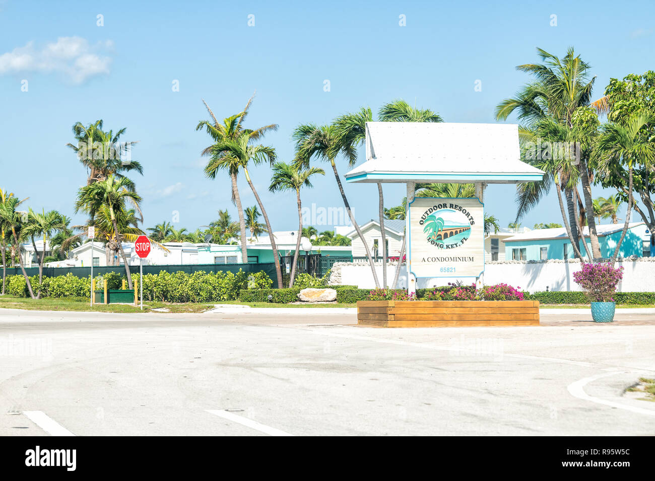 Long Key, USA - May 1, 2018: Outdoor resorts condominium complex sign in Monroe county of Florida keys with many beach vacation houses, homes, palm tr - Stock Image