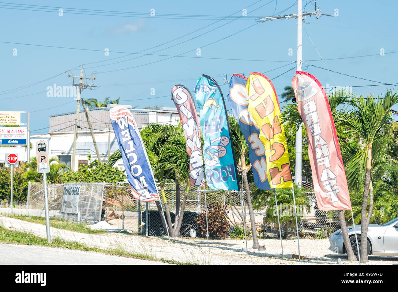 Marathon Usa May 1  Grill Bar Seafood Local Restaurant Signs Colorful Banners Flags Parking Lot On Overseas Highway Road Us1 In