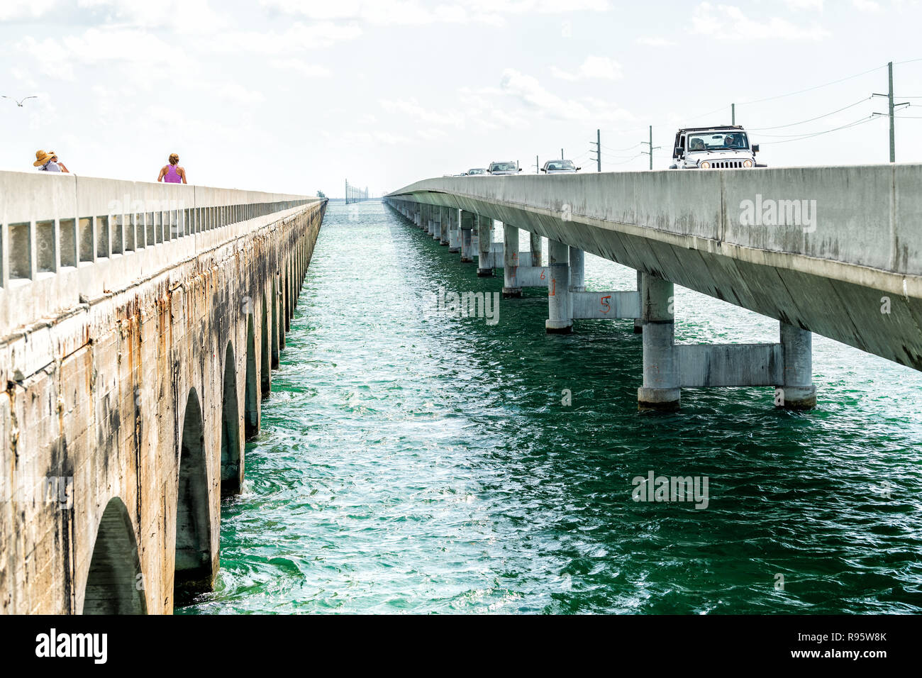 Piegon Key, USA - May 1, 2018: People walking, woman running, jogging at Knights Key-Pigeon Key-Moser Channel-Pacet Channel Bridge (Old Seven Mile Bri - Stock Image