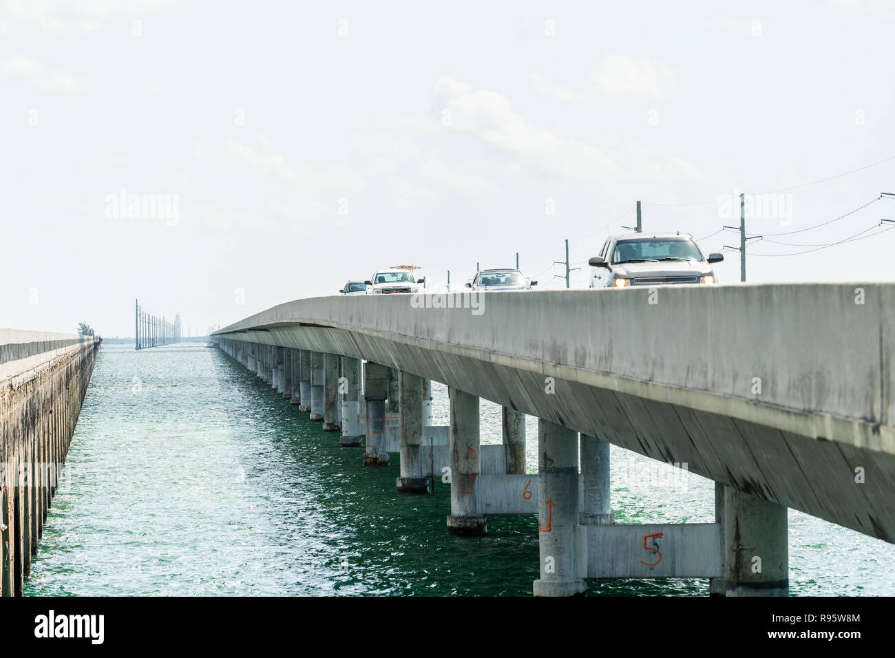 Piegon Key, USA - May 1, 2018: View between Old Seven Mile Knights Key-Pigeon Key-Moser Channel-Pacet Channel Bridge and overseas highway road, ocean, - Stock Image