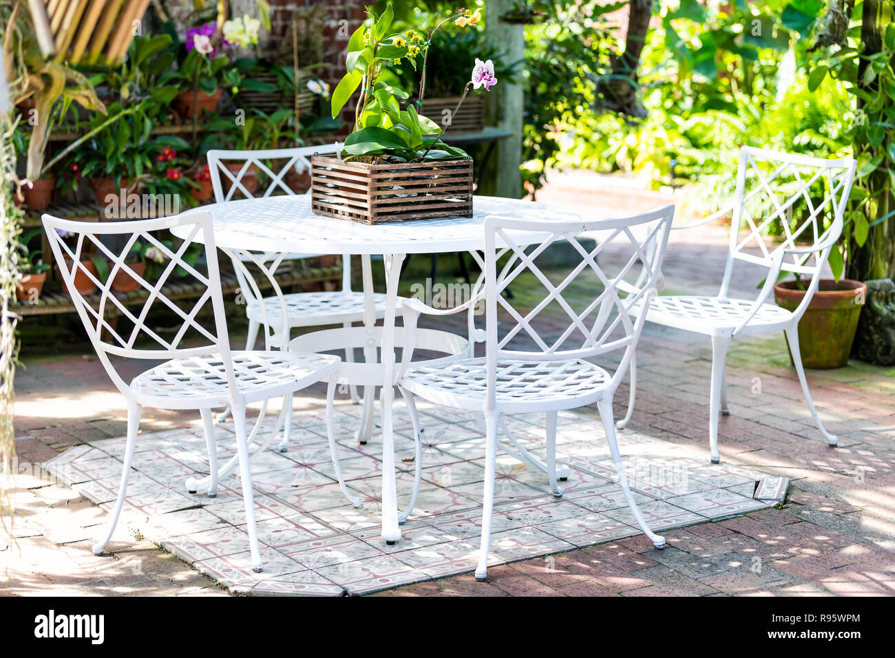 White cast iron chairs, table in outdoor, outside sitting area