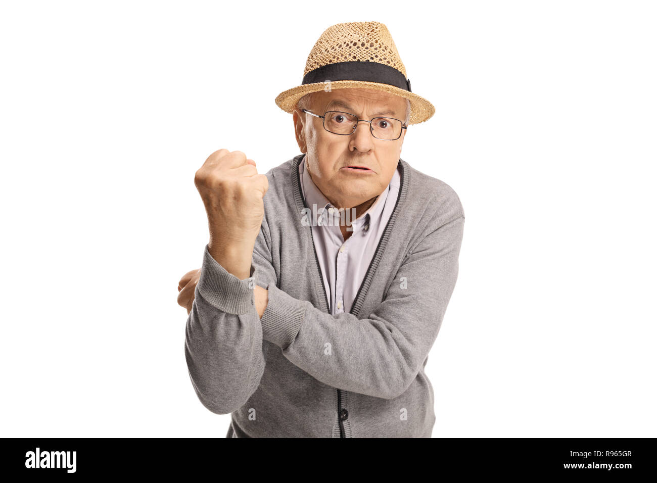 Angry senior man gesturing with hands isolated on white background - Stock Image
