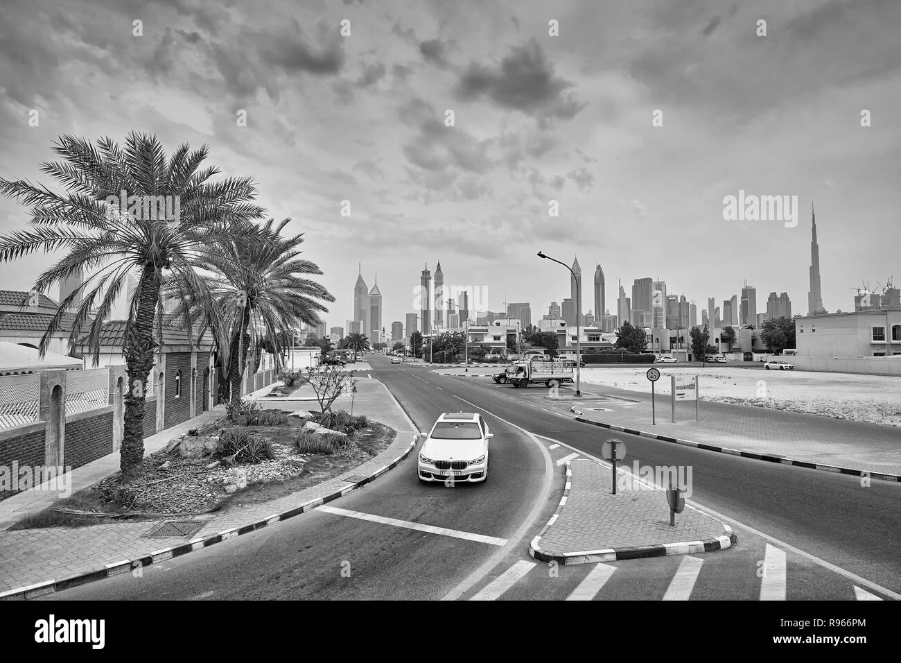 Dubai, United Arab Emirates - May 01, 2017: View of a street with the city iconic skyline. - Stock Image