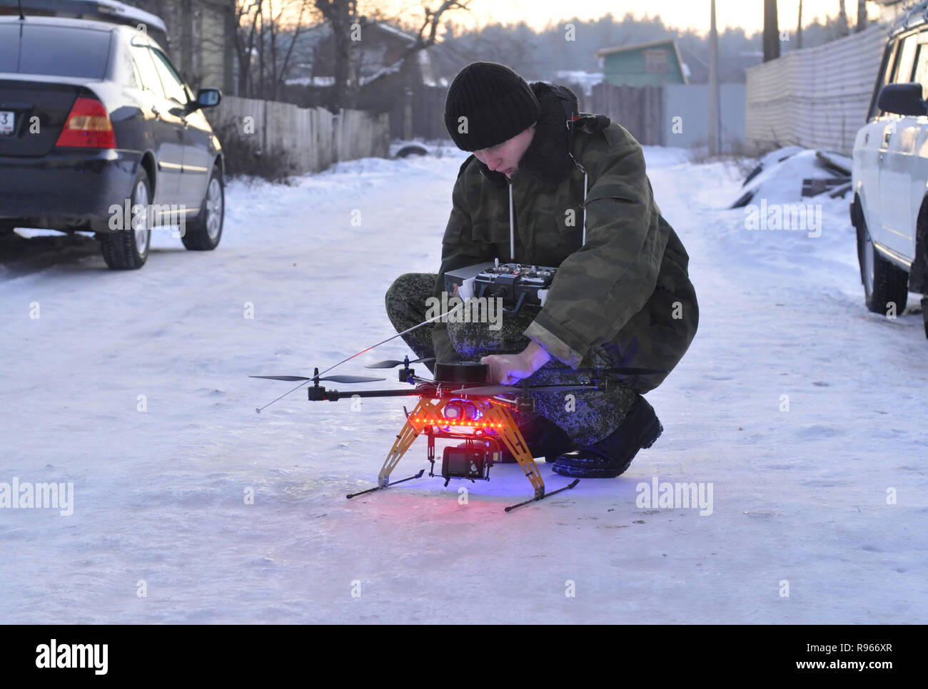 Kovrov, Russia. 16 December 2012. Young man prepares for flight hexacopter with a camera - Stock Image