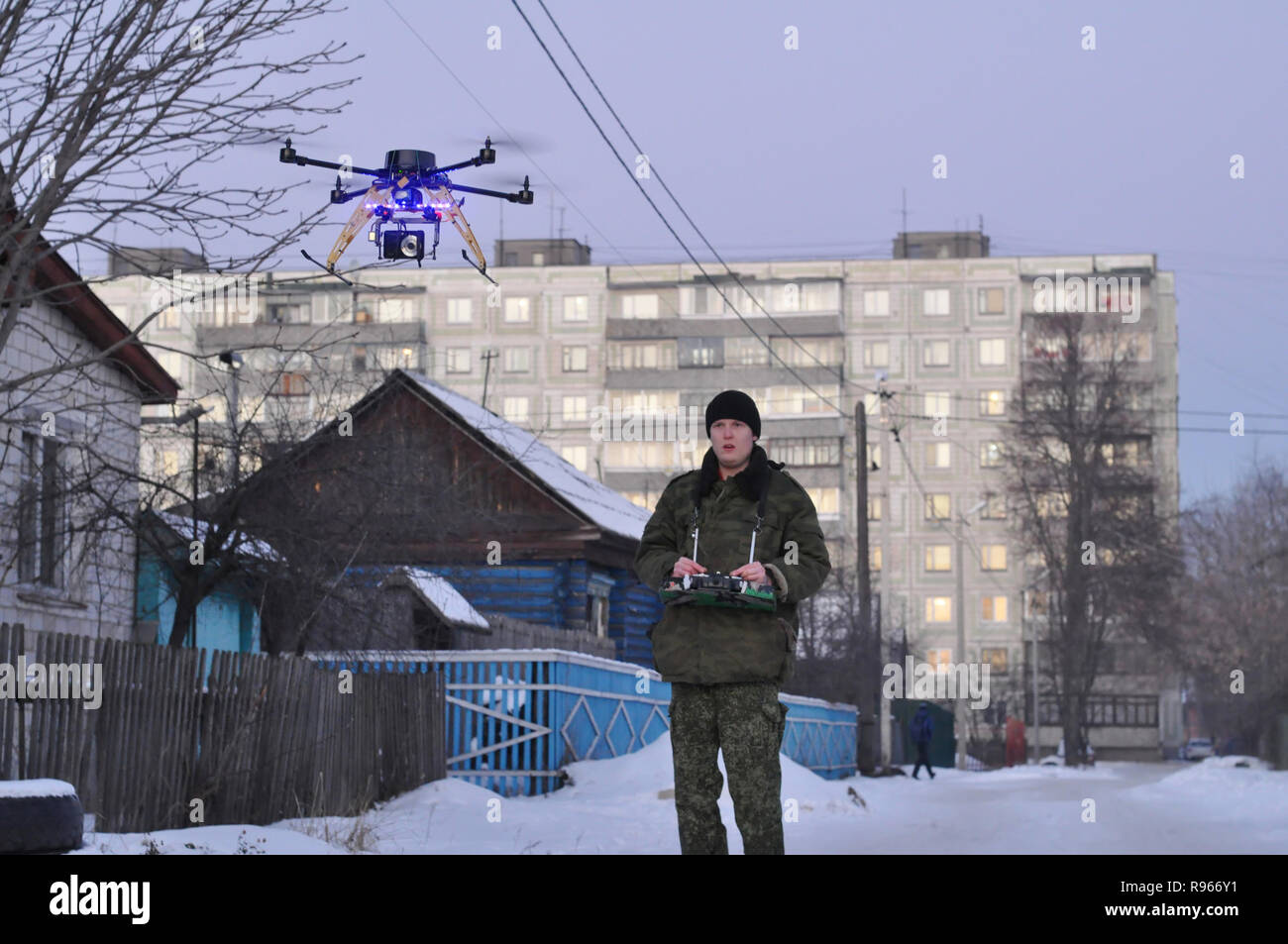 Kovrov, Russia. 16 December 2012. Young man flight controls the hexacopter with a camera - Stock Image