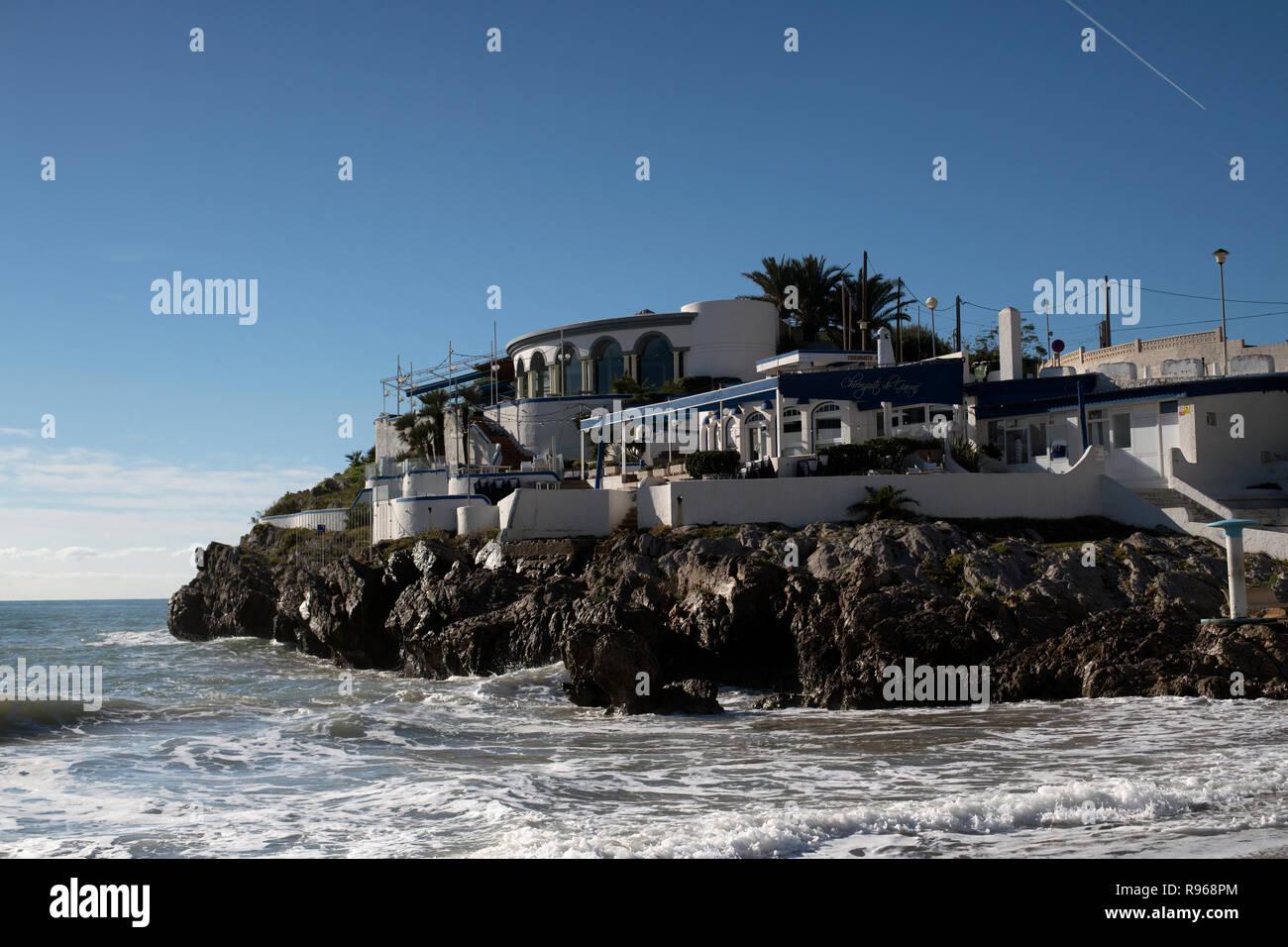 Buildings on rocky ledge overlooking the Mediterranean in Garaff Spain - Stock Image