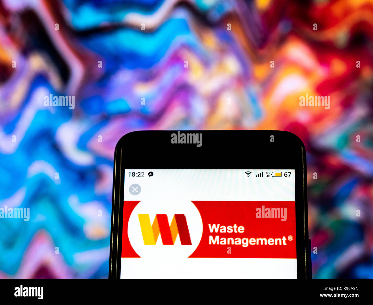 Waste management company logo seen displayed on smart phone Stock