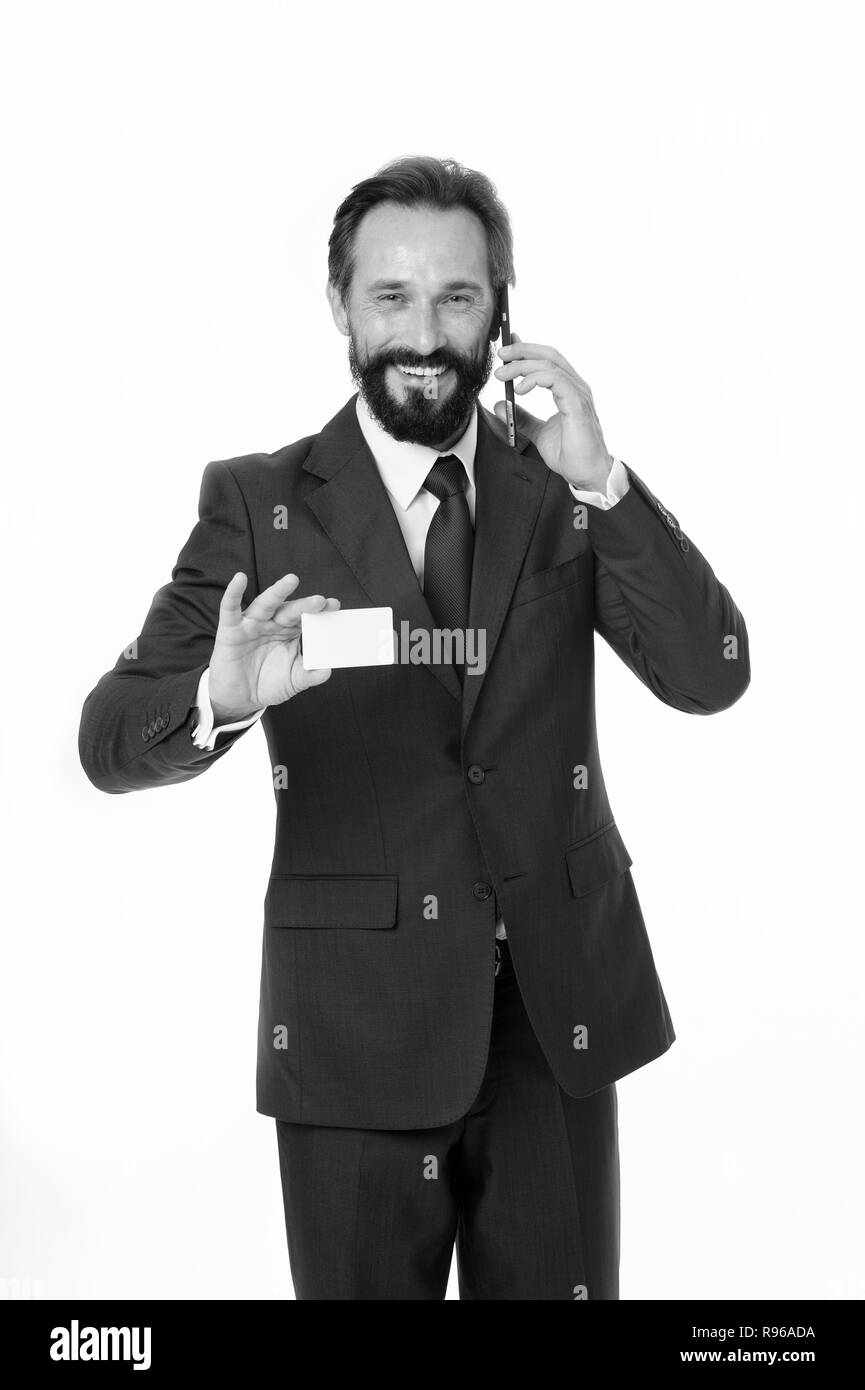 Feel free to call me anytime. Businessman hold plastic blank white card copy space. Businessman carries business card. Call this number. Contact for cooperation. Man speak phone support line. - Stock Image