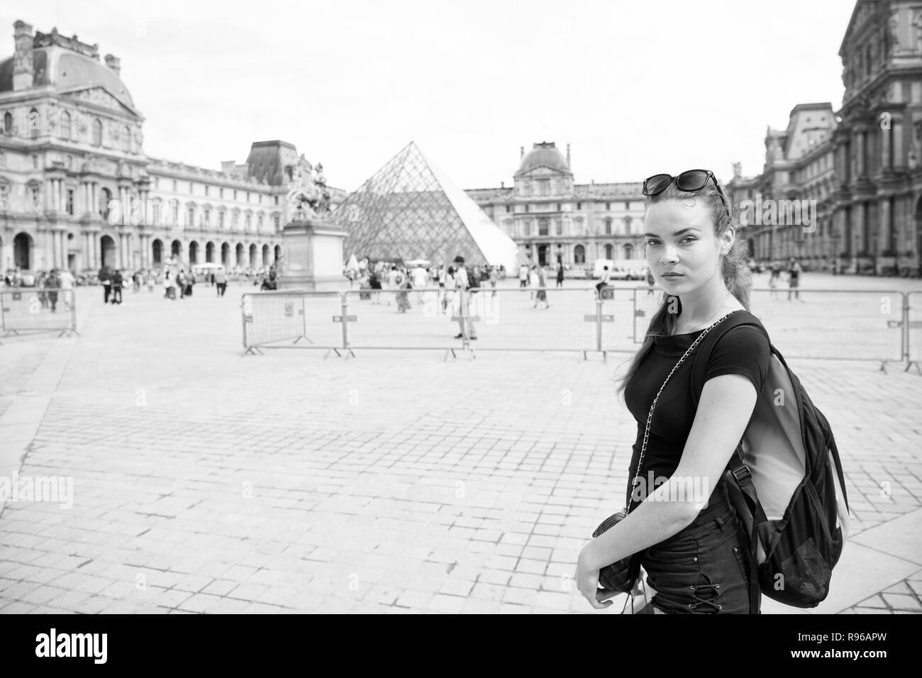 Girl tourist sightseeing walk Paris square city center. Backpacker exploring city. Woman stand in front of urban architecture copy space. Must visit place. Guide for tourists to explore paris. - Stock Image