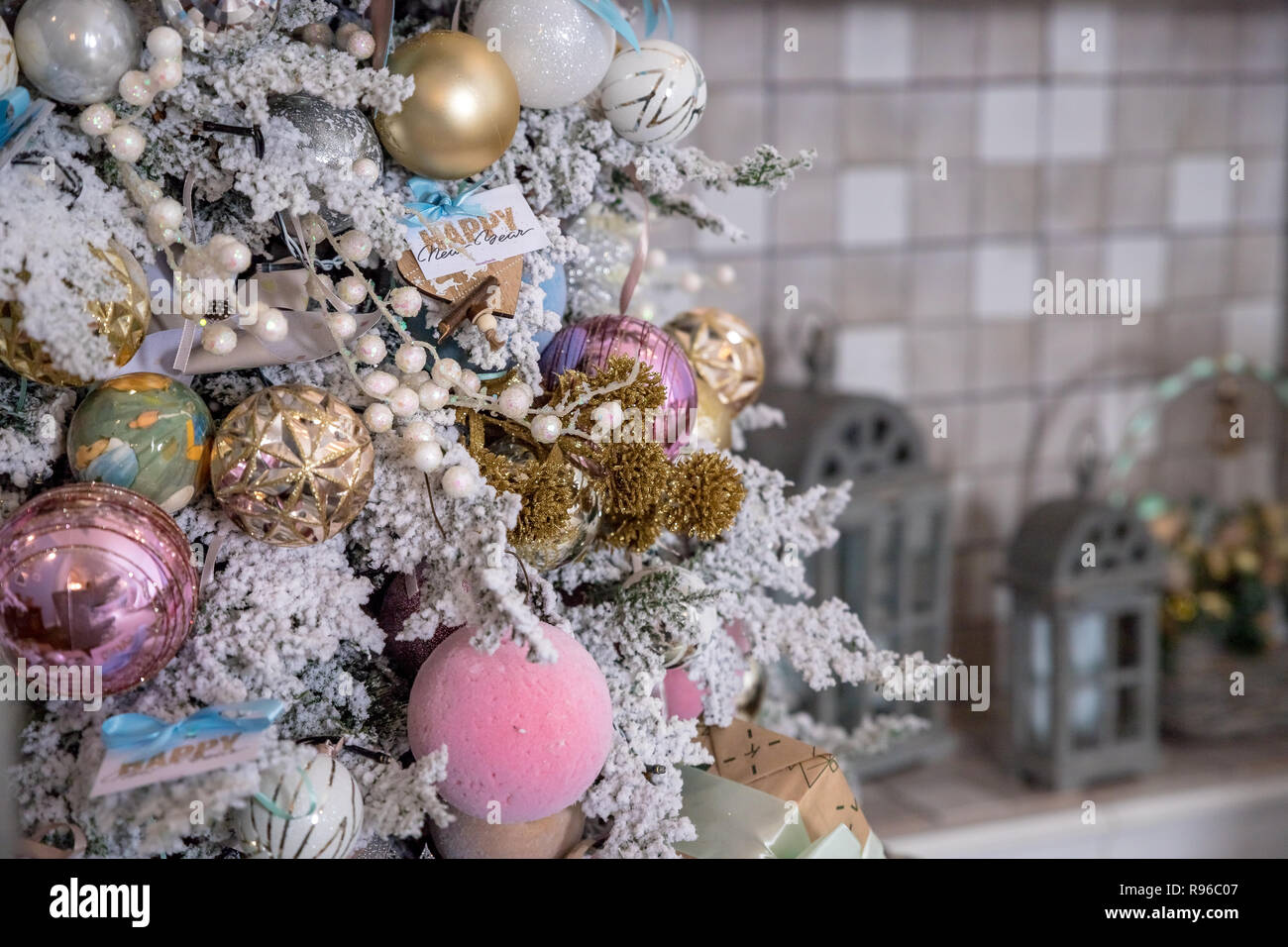 Close Up Of Christmas Tree Decoration With Gold Silver Pink And White Tinsel Glitter Balls And A Snowflake Star Festive Home Decoration Christmas Ornaments Beautiful Decorated Christmas Tree Copy Space Stock Photo Alamy