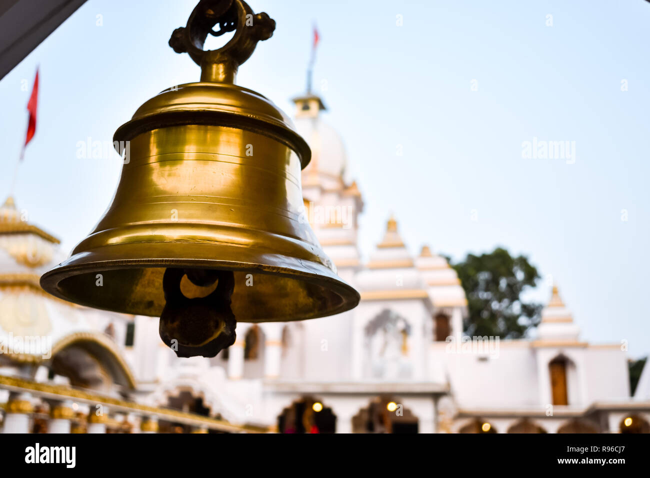 Ring bells in temple. Golden metal bell isolated. Big brass Buddhist bell of Japanese temple. Ringing bell in temple is belief auspicious. Bangkok, Th Stock Photo