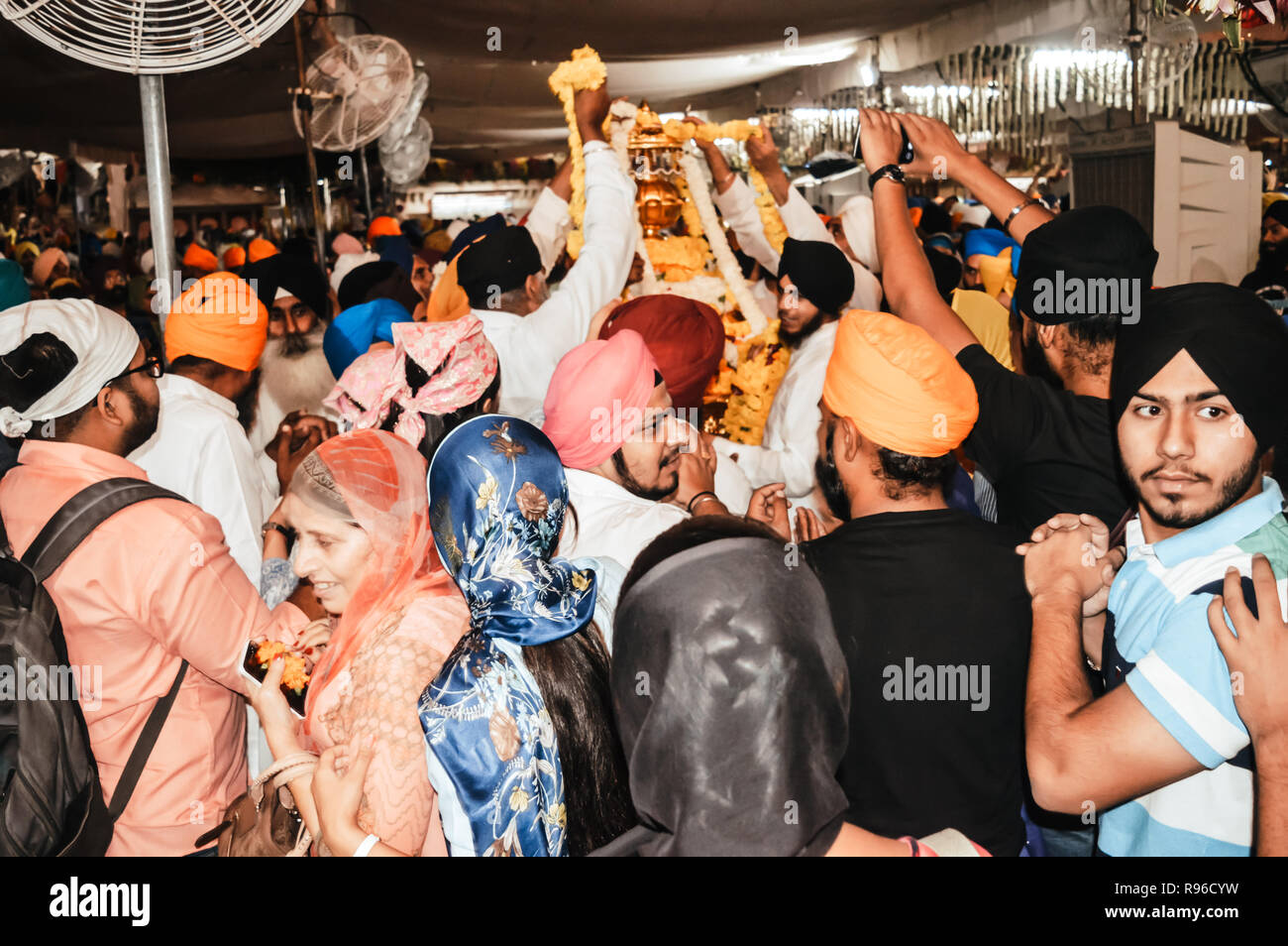 Amritsar, India - MAY 16 2016: Sikh people trying to touch the holi idol when it was taken out of the temple premises for decoration. Golden Temple is - Stock Image