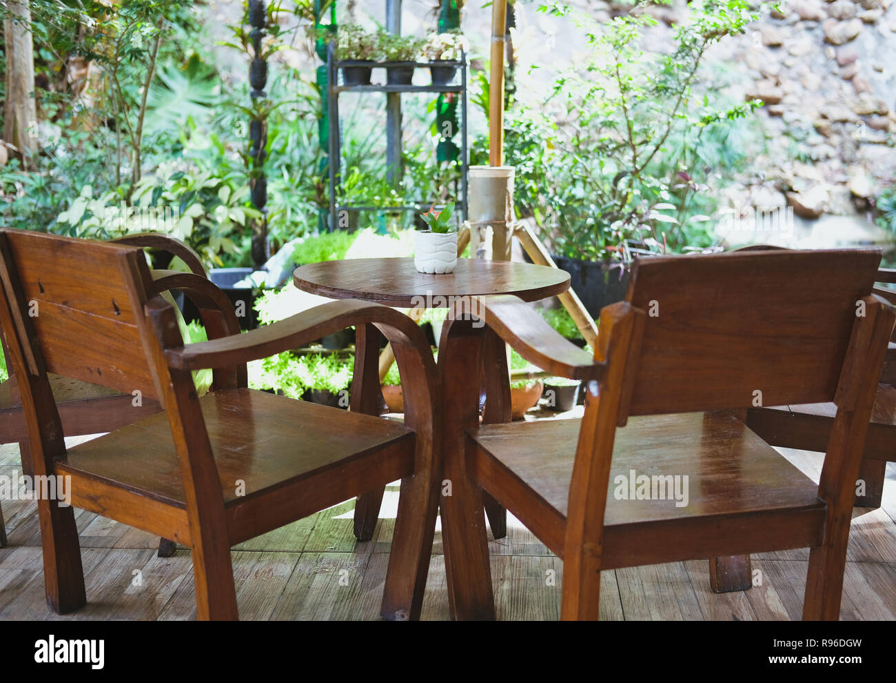 Amazing Wooden Chair Table On Terrace Balcony With Garden View Stock Pabps2019 Chair Design Images Pabps2019Com