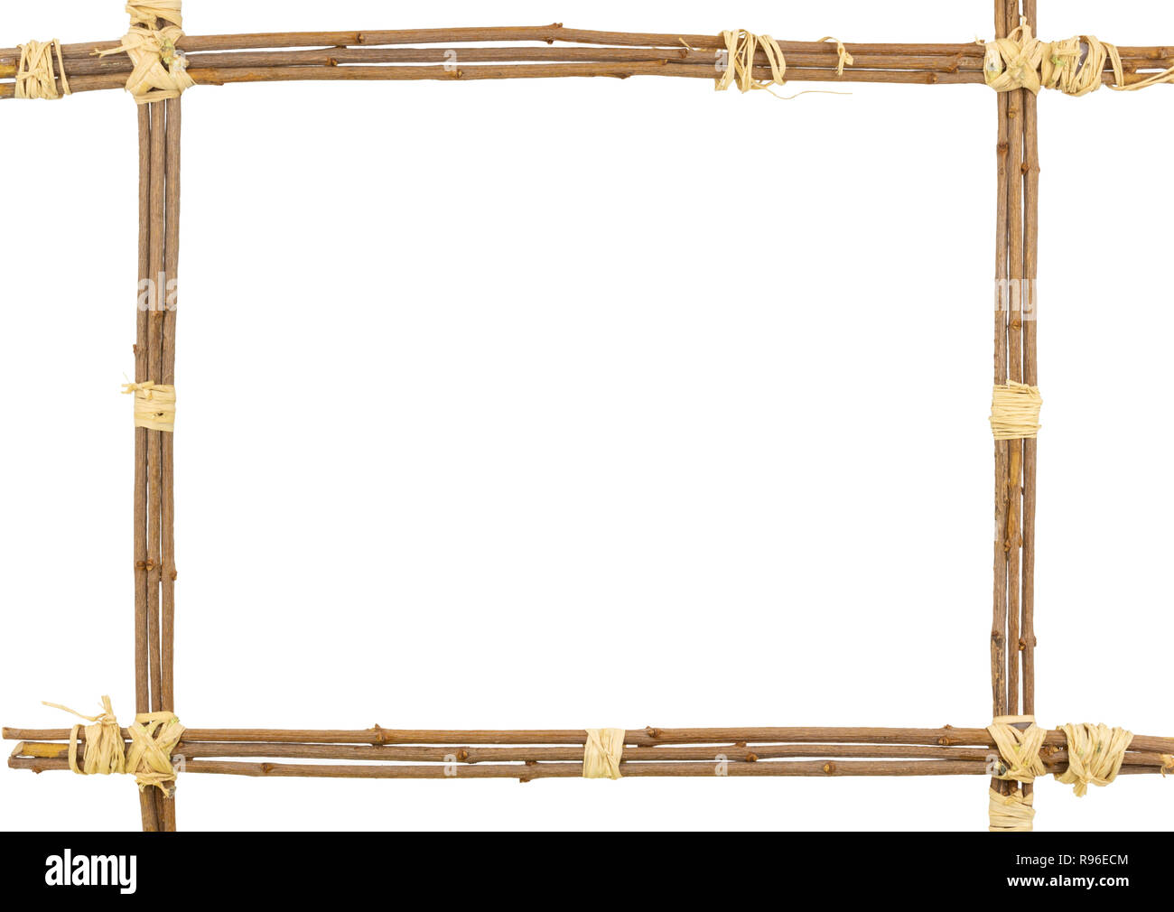 Picture or text frame made of twigs sheaved by the three with raffia fibres. Copy space in the middle. - Stock Image