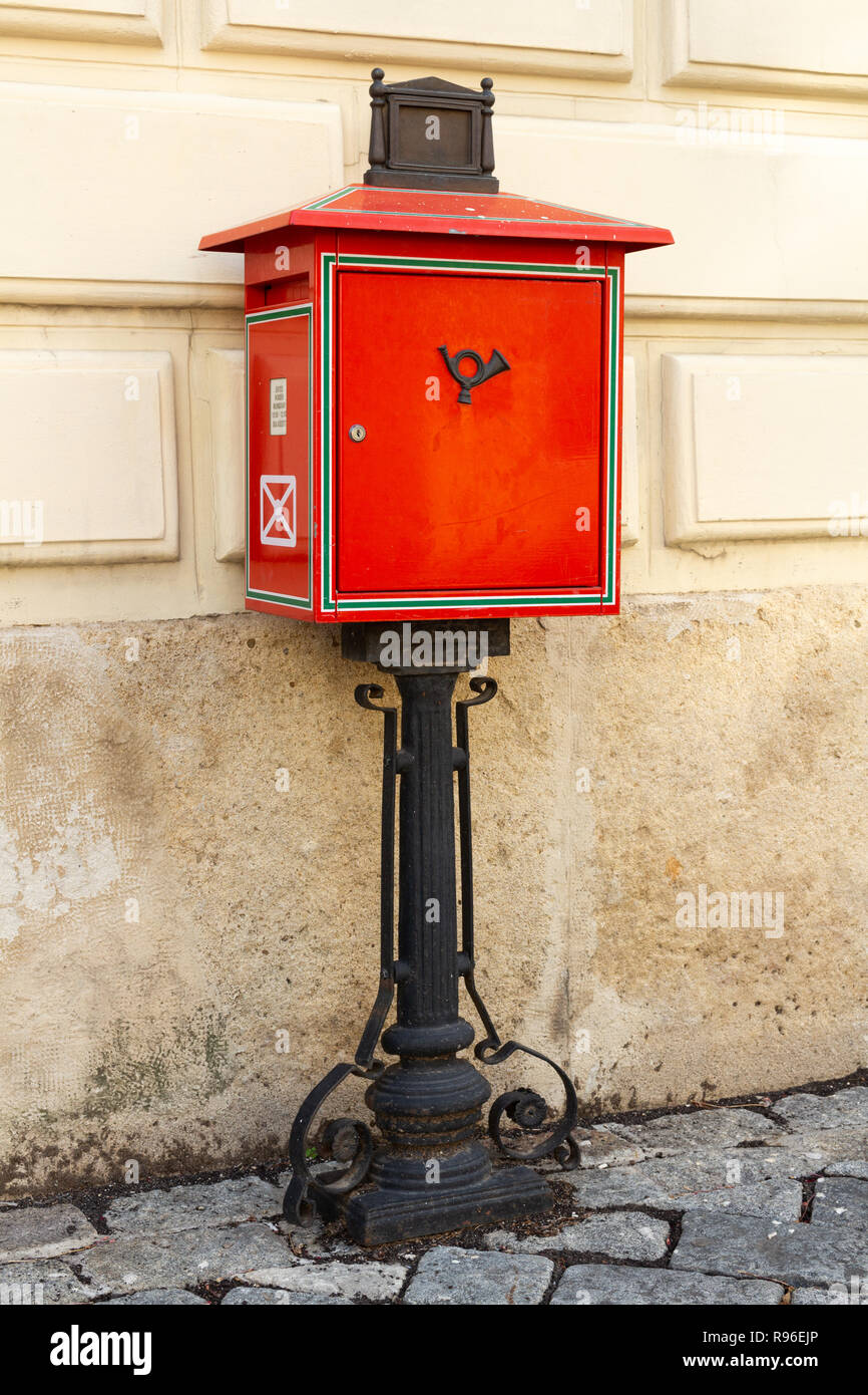 Traditional Red Mailbox On Black Wrought Iron Stand In The Main Square Of Sopron Hungary Vertical Image Stock Photo Alamy