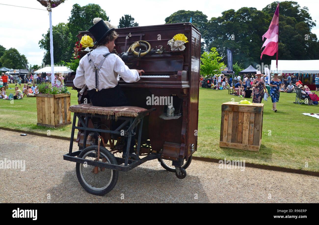 Rimski's piano bicycle at the Waddesdon Feast Weekend, Waddesdon Manor, Aylesbury, Buckinghamshire. UK. Entertainment in the gardens. - Stock Image