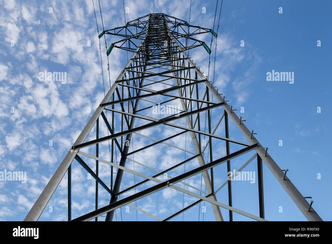 high voltage power line on metal poles - Stock Image