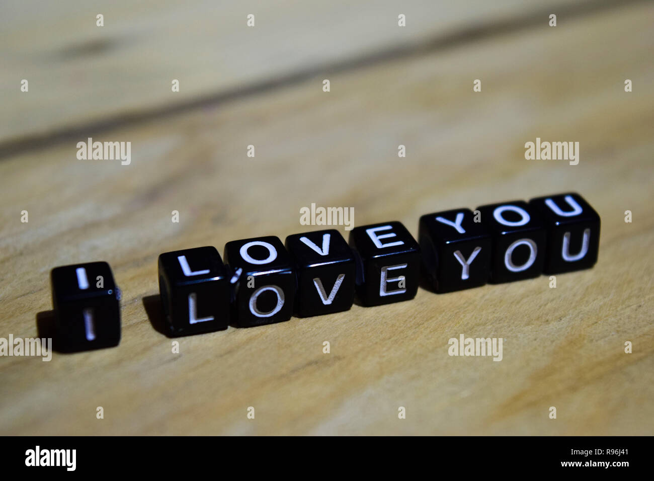I love you written on wooden blocks. Inspiration and motivation concepts. Cross processed image on Wooden Background Stock Photo