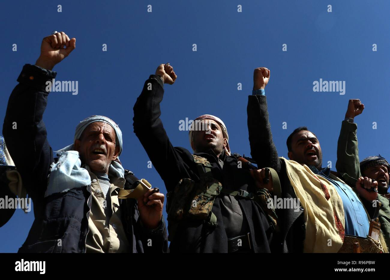 Beijing, Yemen. 19th Dec, 2018. Yemen's Houthi followers shout slogans during a rally to celebrate and support the UN-brokered cease-fire in Hodeidah, in Sanaa, Yemen, on Dec. 19, 2018. The cease-fire agreement reached between the Yemeni government and Houthi rebels during the UN-sponsored peace talks in Sweden went into effect on Dec. 17. Credit: Mohammed Mohammed/Xinhua/Alamy Live News - Stock Image