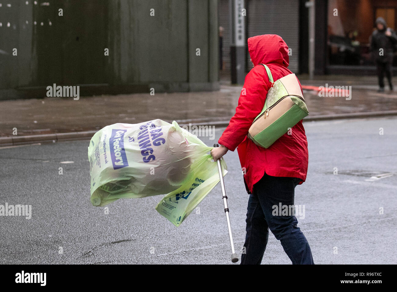 Southport, Merseyside, UK. 20th Dec, 2018. Wet & windy day for Christmas shoppers as the sale signs go up in retail outlets discounting items across the store in an attempt to stimulate festive high street sales. Credit: MediaWorldImages/Alamy Live News - Stock Image