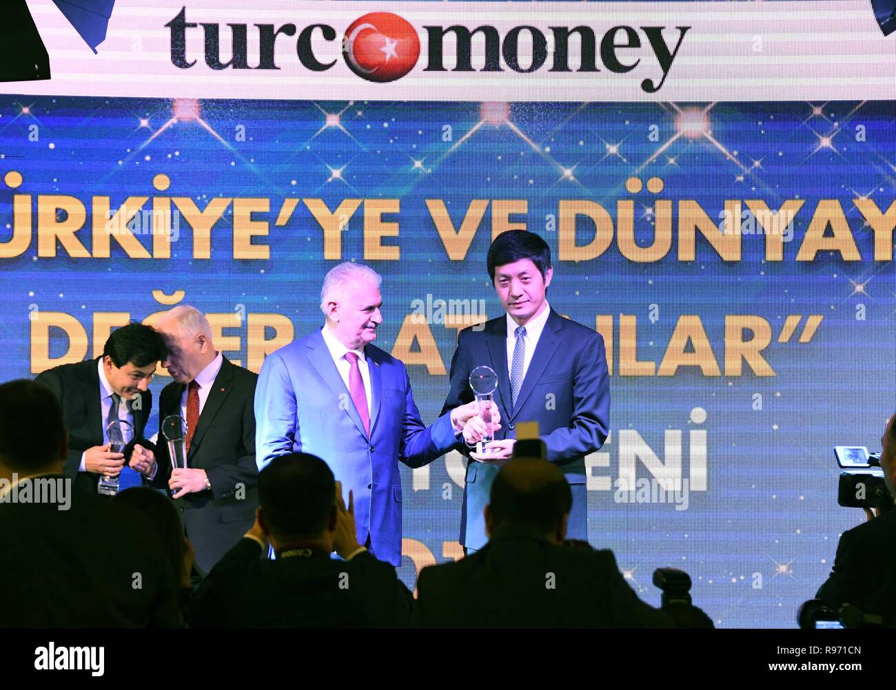 Istanbul, Turkey. 20th Dec, 2018. Binali Yildirim (2nd R), speaker of the Grand National Assembly of Turkey, grants the award of 'International Bank of the Year' to Gao Xiangyang (1st R), chairman of ICBC Turkey, at an awarding ceremony in Istanbul, Turkey, Dec. 20, 2018. ICBC Turkey, a branch of the Industrial and Commercial Bank of China (ICBC), on Thursday was named the 'International Bank of the Year' for its 'distinguished contributions' to Turkey's economy. Credit: Xu Suhui/Xinhua/Alamy Live News - Stock Image