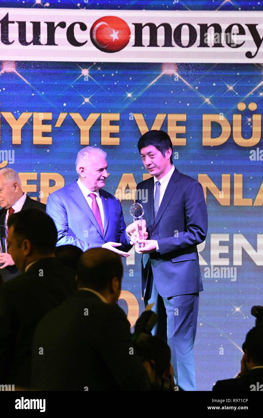 Istanbul, Turkey. 20th Dec, 2018. Binali Yildirim (L), speaker of the Grand National Assembly of Turkey, grants the award of 'International Bank of the Year' to Gao Xiangyang, chairman of ICBC Turkey, at an awarding ceremony in Istanbul, Turkey, Dec. 20, 2018. ICBC Turkey, a branch of the Industrial and Commercial Bank of China (ICBC), on Thursday was named the 'International Bank of the Year' for its 'distinguished contributions' to Turkey's economy. Credit: Xu Suhui/Xinhua/Alamy Live News - Stock Image