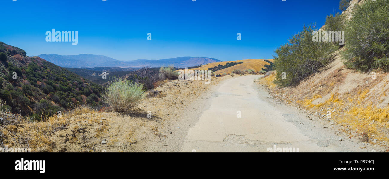 Narrow mountain road leads through Angeles National forest in southern California. - Stock Image