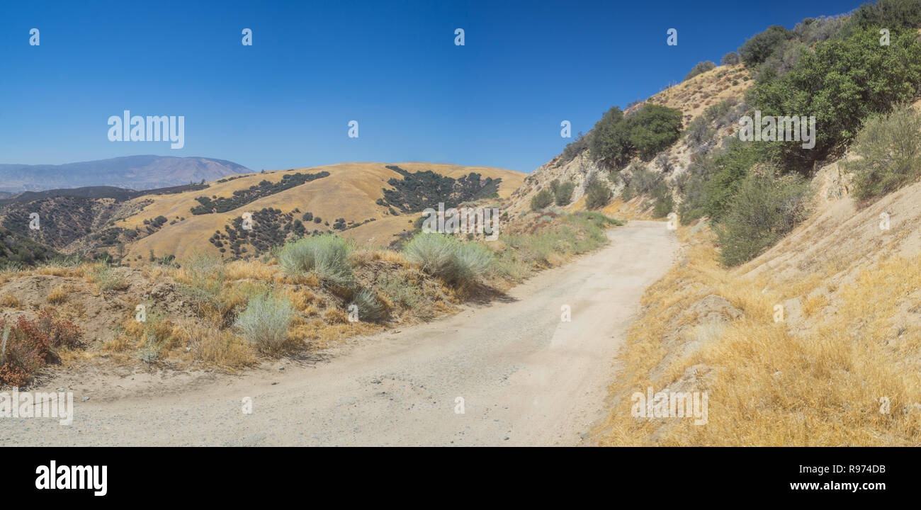 Panoramic view of dirt road in California mountains in Angeles National Forest. - Stock Image