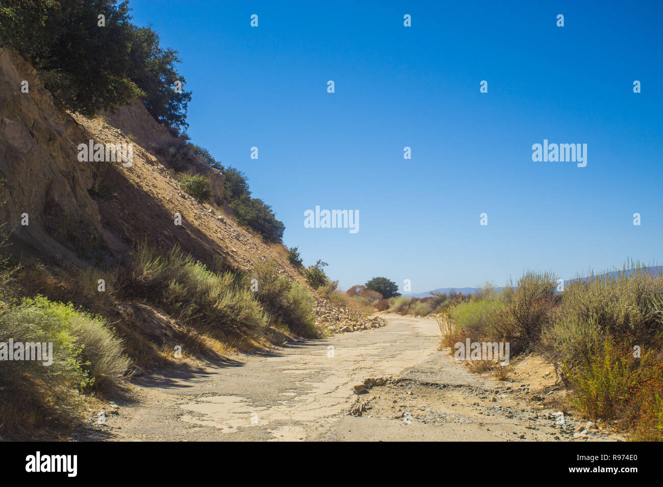 Rugged driving trail leads long the edge of the mountains in southern California near Gorman. - Stock Image