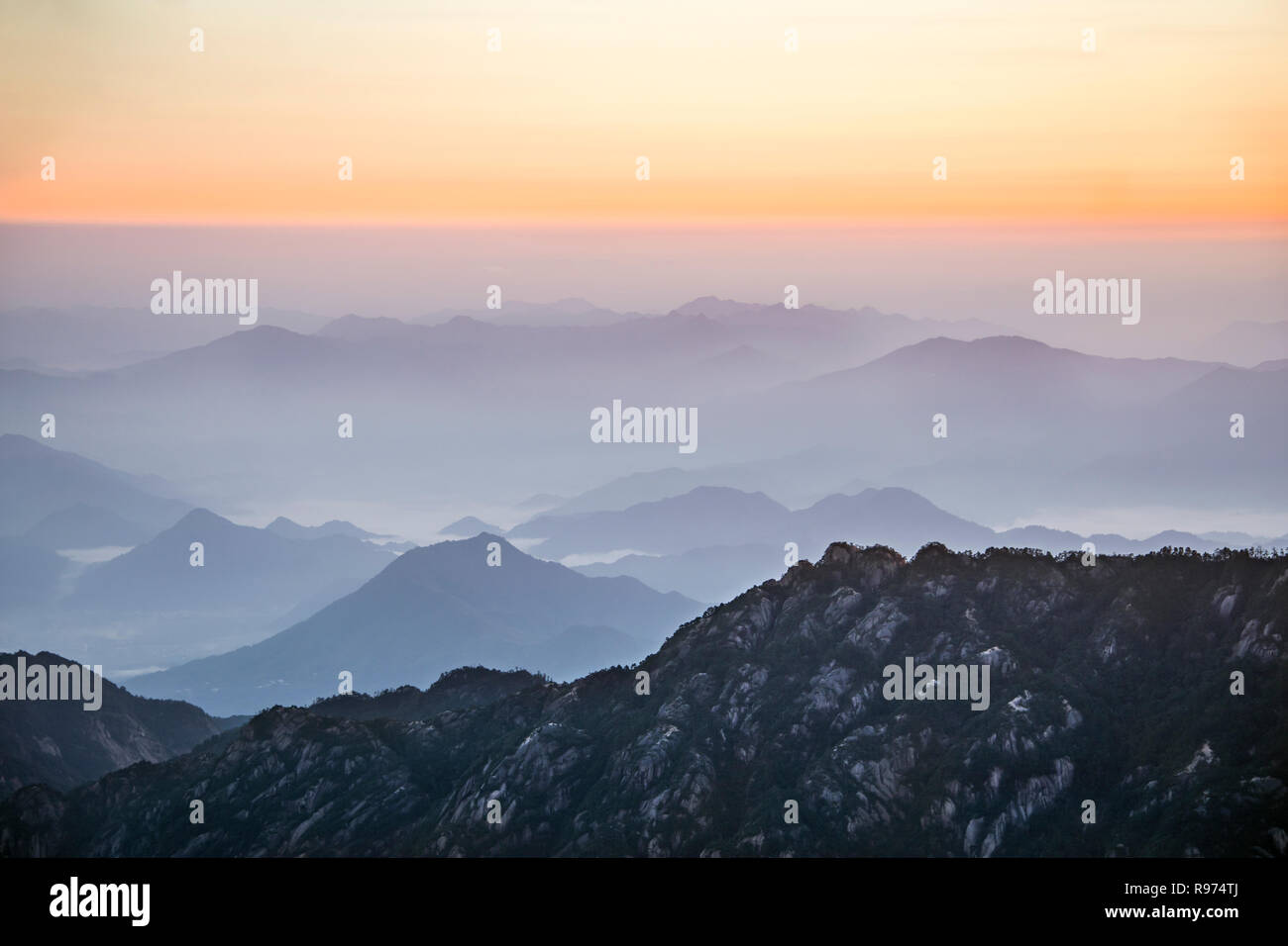 Huangshan National Park at sunrise with mists and pollution, Anhui, China - Stock Image