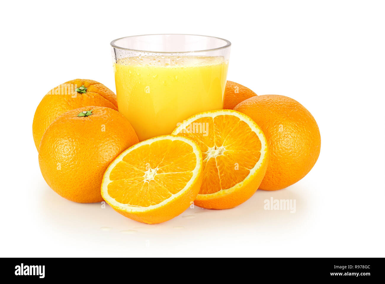 16004856 - fresh orange juice and oranges over a white background with shadow. - Stock Image